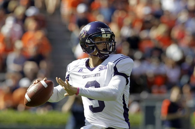 Oct 12, 2013; Auburn, AL, USA; Western Carolina Catamounts quarterback Eddie Sullivan (9) drops back to pass against the Auburn Tigers during the second half at Jordan Hare Stadium.  The Tigers beat the Catamounts 62-3.  Mandatory Credit: John Reed-USA TODAY Sports