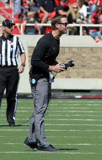 Oct 12, 2013; Lubbock, TX, USA; Texas Tech Red Raiders head coach Kliff Kingsbury questions a call in the game against the Iowa State Cyclones at Jones AT&T Stadium. Mandatory Credit: Michael C. Johnson-USA TODAY Sports