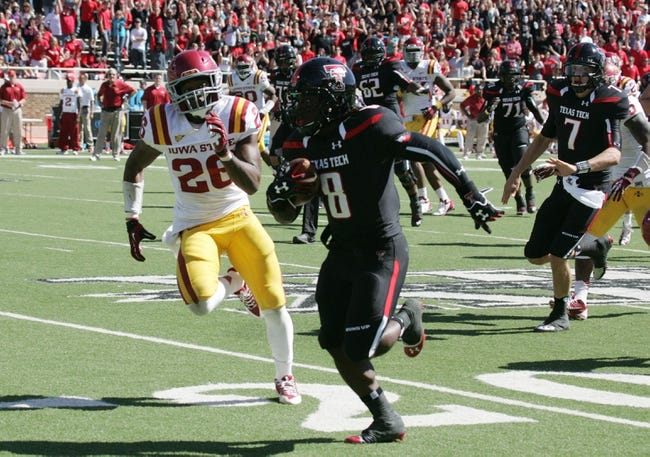 Oct 12, 2013; Lubbock, TX, USA; Texas Tech Red Raiders running back Sadale Foster (8) rushes for a touchdown in the second half against the Iowa State Cyclones at Jones AT&T Stadium. Mandatory Credit: Michael C. Johnson-USA TODAY Sports