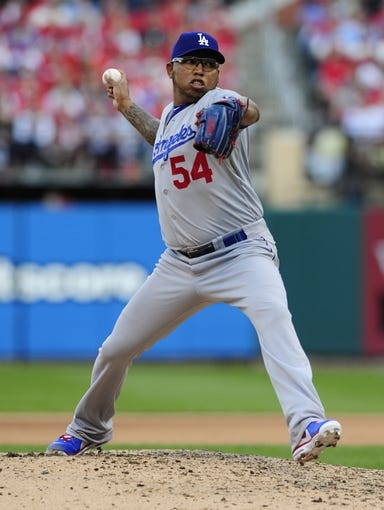 Oct 12, 2013; St. Louis, MO, USA; Los Angeles Dodgers relief pitcher Ronald Belisario throws a pitch against the St. Louis Cardinals during the 7th inning in game two of the National League Championship Series baseball game at Busch Stadium. Mandatory Credit: Jeff Curry-USA TODAY Sports