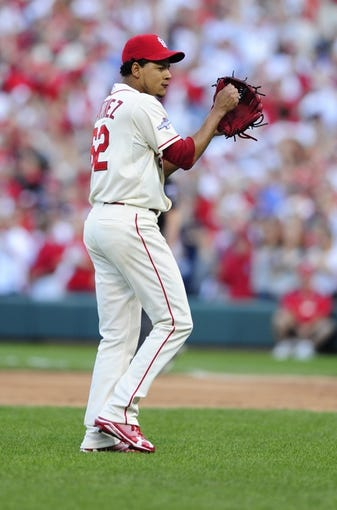 Oct 12, 2013; St. Louis, MO, USA; St. Louis Cardinals relief pitcher Carlos Martinez (62) reacts after retiring the Los Angeles Dodgers during the 8th inning in game two of the National League Championship Series baseball game at Busch Stadium. Mandatory Credit: Jeff Curry-USA TODAY Sports