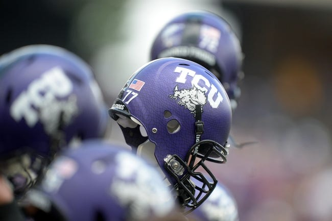 Oct 12, 2013; Fort Worth, TX, USA; General view of TCU Horned Frog players hoisting their helmets at the start of the game against the Kansas Jayhawks at Amon G. Carter Stadium. TCU defeated Kansas 27-17. Mandatory Credit: Kirby Lee-USA TODAY Sports
