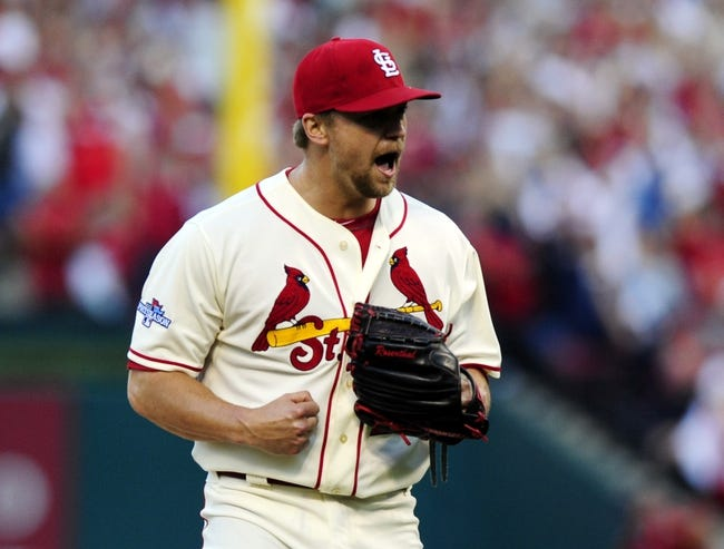 Oct 12, 2013; St. Louis, MO, USA; St. Louis Cardinals relief pitcher Trevor Rosenthal celebrates after recording the final out in game two of the National League Championship Series baseball game against the Los Angeles Dodgers at Busch Stadium. Mandatory Credit: Jeff Curry-USA TODAY Sports