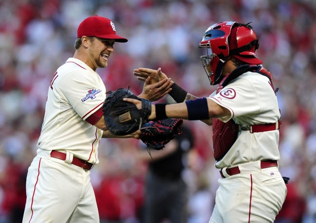 Oct 12, 2013; St. Louis, MO, USA; St. Louis Cardinals relief pitcher Trevor Rosenthal (left) celebrates with catcher Yadier Molina after game two of the National League Championship Series baseball game against the Los Angeles Dodgers at Busch Stadium. Mandatory Credit: Jeff Curry-USA TODAY Sports