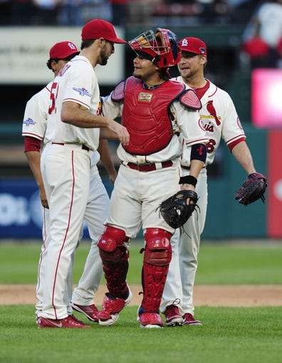 Oct 12, 2013; St. Louis, MO, USA; St. Louis Cardinals starting pitcher Michael Wacha (left) celebrates with catcher Yadier Molina after game two of the National League Championship Series baseball game against the Los Angeles Dodgers at Busch Stadium. Mandatory Credit: Jeff Curry-USA TODAY Sports