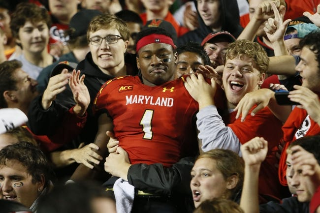 Oct 12, 2013; College Park, MD, USA; Maryland Terrapins wide receiver Stefon Diggs (1) celebrates with students in the stands immediately following the teams 27-26 win over the Virginia Cavaliers at Byrd Stadium. Mandatory Credit: Mitch Stringer-USA TODAY Sports