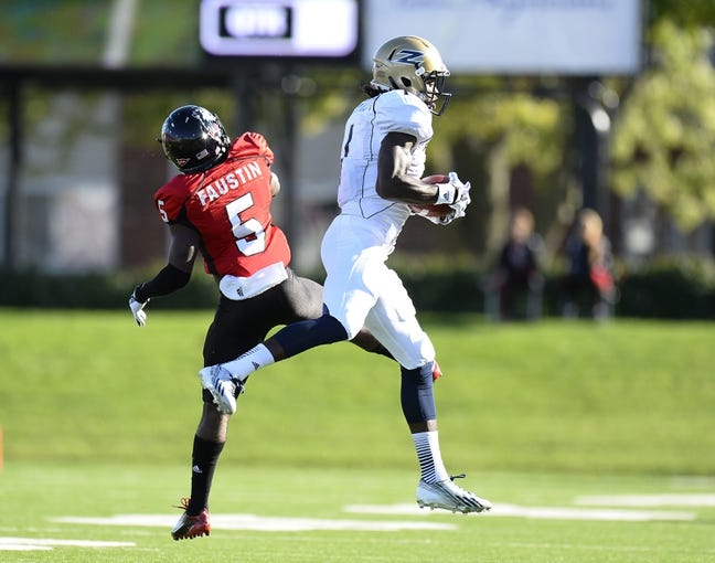 Oct 12, 2013; DeKalb, IL, USA; Akron Zips wide receiver Mykel Traylor-Bennett (1) makes a catch against Northern Illinois Huskies cornerback Jhony Faustin (5) during the first half at Huskie Stadium. Mandatory Credit: Mike DiNovo-USA TODAY Sports