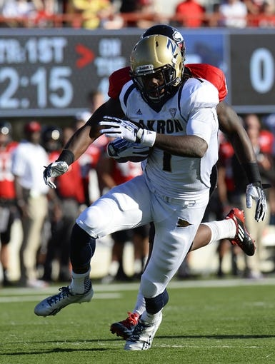 Oct 12, 2013; DeKalb, IL, USA; Akron Zips wide receiver Mykel Traylor-Bennett (1) makes a catch against the Northern Illinois Huskies during the first half at Huskie Stadium. Mandatory Credit: Mike DiNovo-USA TODAY Sports