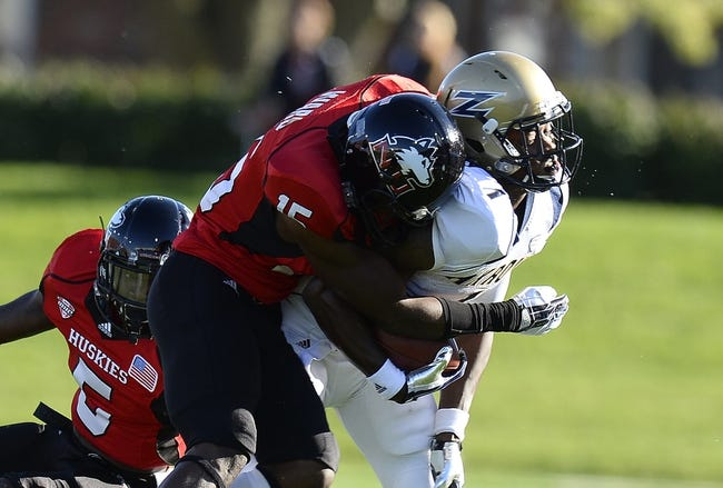 Oct 12, 2013; DeKalb, IL, USA; Northern Illinois Huskies safety Jimmie Ward (15) makes a tackle on Akron Zips wide receiver Mykel Traylor-Bennett (1) during the first half at Huskie Stadium. Mandatory Credit: Mike DiNovo-USA TODAY Sports