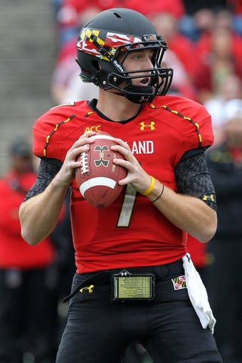 Oct 12, 2013; College Park, MD, USA; Maryland Terrapins quarterback Caleb Rowe (7) during the teams 27-26 win over the Virginia Cavaliers at Byrd Stadium. Mandatory Credit: Mitch Stringer-USA TODAY Sports