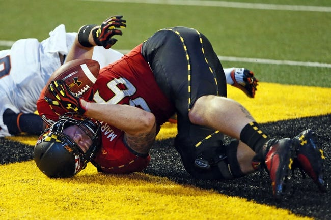 Oct 12, 2013; College Park, MD, USA; Maryland Terrapins tight end Dave Stinebaugh (86) rolls over in the end zone after making the game winning catch against the Virginia Cavaliers at Byrd Stadium. Mandatory Credit: Mitch Stringer-USA TODAY Sports