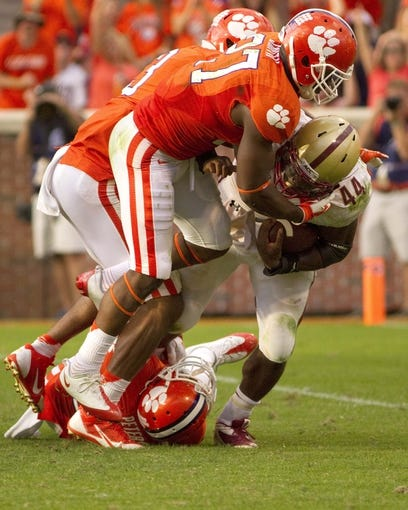 Oct 12, 2013; Clemson, SC, USA; Boston College Eagles running back Andre Williams (44) is brought down by Clemson Tigers safety Robert Smith (27) during the second half at Clemson Memorial Stadium. Tigers won 24-14. Mandatory Credit: Joshua S. Kelly-USA TODAY Sports
