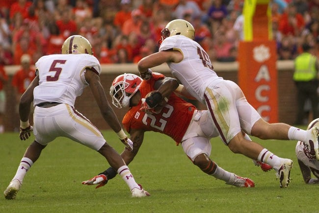 Oct 12, 2013; Clemson, SC, USA; Clemson Tigers running back Roderick McDowell (25) is tackled by Boston College Eagles defensive back Sean Sylvia (19) during the second half at Clemson Memorial Stadium. Tigers won 24-14. Mandatory Credit: Joshua S. Kelly-USA TODAY Sports