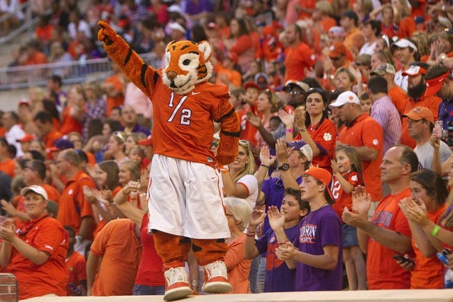 Oct 12, 2013; Clemson, SC, USA; Clemson Tigers mascot cheers with fans during the second half against the Boston College Eagles at Clemson Memorial Stadium. Tigers won 24-14. Mandatory Credit: Joshua S. Kelly-USA TODAY Sports