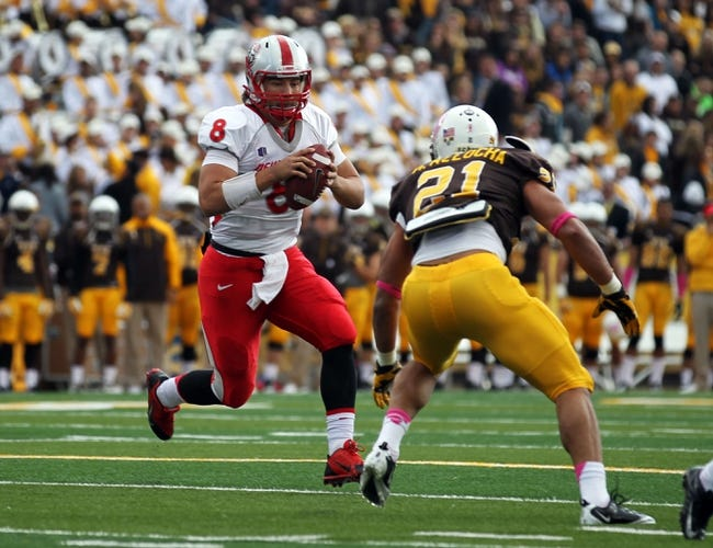 Oct 12, 2013; Laramie, WY, USA; Laramie, WY, USA; New Mexico Lobos quarterback Cole Gautsche (8) runs against Wyoming Cowboys linebacker Mark Nzeocha (21) during the first quarter at War Memorial Stadium.  The Cowboys beat the Lobos 38-31. Mandatory Credit: Troy Babbitt-USA TODAY Sports