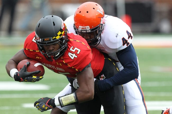 Oct 12, 2013; College Park, MD, USA; Maryland Terrapins running back Brandon Ross (45) tackled after a gain by Virginia Cavaliers linebacker Henry Coley (44) at Byrd Stadium. Mandatory Credit: Mitch Stringer-USA TODAY Sports