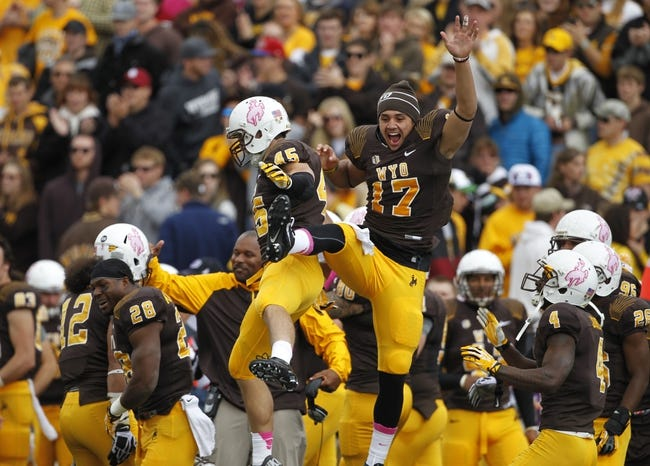 Oct 12, 2013; Laramie, WY, USA; Laramie, WY, USA; Wyoming Cowboys linebacker Lucas Wacha (45) and quarterback Jason Thompson (17) celebrate a fumble recovery against the New Mexico Lobos during the first quarter at War Memorial Stadium. The Cowboys beat the Lobos 38-31. Mandatory Credit: Troy Babbitt-USA TODAY Sports
