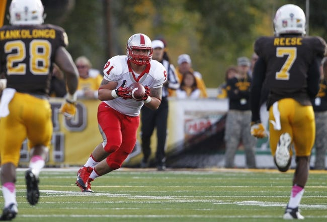 Oct 12, 2013; Laramie, WY, USA; Laramie, WY, USA; New Mexico Lobos defensive lineman Nik D'Avanzo (91) returns a kickoff against Wyoming Cowboys linebacker Nehemie Kankolongo (28) and safety Chad Reese (7) during the fourth quarter at War Memorial Stadium. The Cowboys beat the Lobos 38-31. Mandatory Credit: Troy Babbitt-USA TODAY Sports