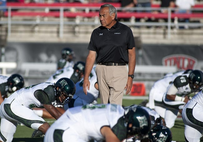 Oct 12, 2013; Las Vegas, NV, USA; Hawaii Rainbow Warriors head coach Norm Chow looks over his players as they prepare to take on the UNLV Rebels at Sam Boyd Stadium. Mandatory Credit: Stephen R. Sylvanie-USA TODAY Sports