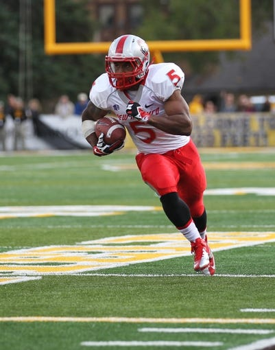 Oct 12, 2013; Laramie, WY, USA; Laramie, WY, USA; New Mexico Lobos running back Kasey Carrier (5) scores a touchdown against the Wyoming Cowboys during the fourth quarter at War Memorial Stadium. The Cowboys beat the Lobos 38-31. Mandatory Credit: Troy Babbitt-USA TODAY Sports