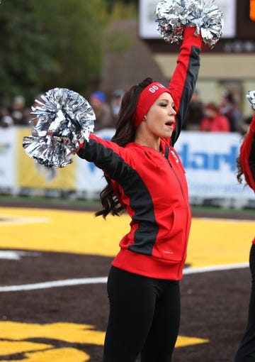 Oct 12, 2013; Laramie, WY, USA; Laramie, WY, USA; A New Mexico Lobos cheerleader performs during a game against the Wyoming Cowboys during the fourth quarter at War Memorial Stadium. The Cowboys beat the Lobos 38-31. Mandatory Credit: Troy Babbitt-USA TODAY Sports