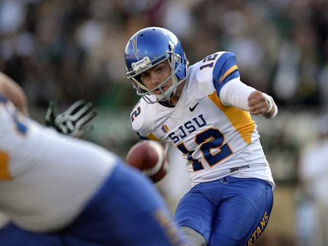 Oct 12, 2013; Fort Collins, CO, USA; San Jose State Spartans kicker Austin Lopez (12) kicks the go head field goal in the third quarter against the Colorado State Rams at Hughes Stadium. The Spartans defeated the Rams 34-27. Mandatory Credit: Ron Chenoy-USA TODAY Sports