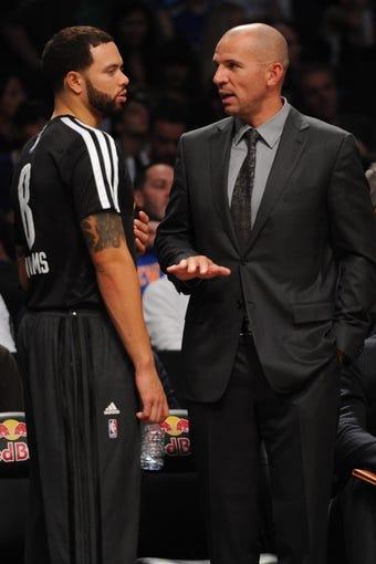 Oct 12, 2013; Brooklyn, NY, USA; Brooklyn Nets head coach Jason Kidd and Brooklyn Nets point guard Deron Williams (8) talk during the first half of the preseason game at Barclays Center. Mandatory Credit: Joe Camporeale-USA TODAY Sports