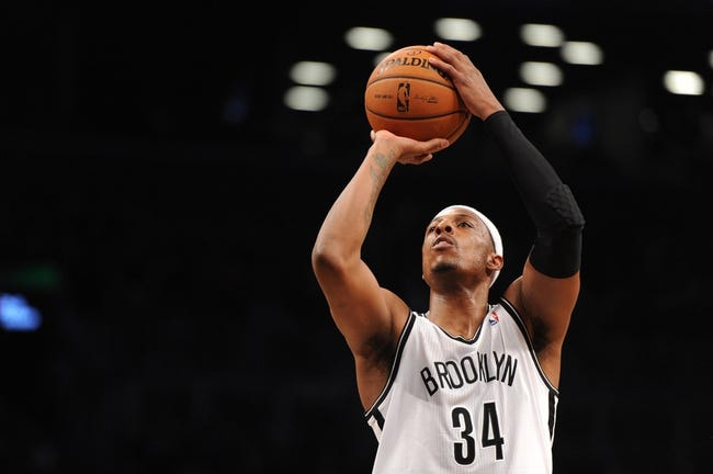 Oct 12, 2013; Brooklyn, NY, USA; Brooklyn Nets small forward Paul Pierce (34) takes a free throw against the Detroit Pistons during the first half of the preseason game at Barclays Center. Mandatory Credit: Joe Camporeale-USA TODAY Sports