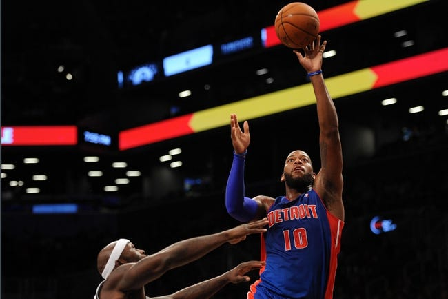 Oct 12, 2013; Brooklyn, NY, USA; Detroit Pistons center Greg Monroe (10) puts up a shot over Brooklyn Nets power forward Reggie Evans (30) during the first half of the preseason game at Barclays Center. Mandatory Credit: Joe Camporeale-USA TODAY Sports
