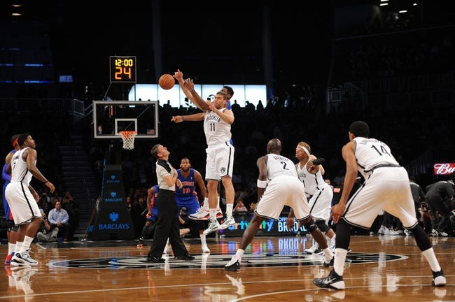 Oct 12, 2013; Brooklyn, NY, USA; Brooklyn Nets center Brook Lopez (11) wins the opening tip against the Detroit Pistons during the first half of the preseason game at Barclays Center. Mandatory Credit: Joe Camporeale-USA TODAY Sports
