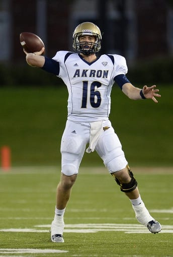 Oct 12, 2013; DeKalb, IL, USA; Akron Zips quarterback Kyle Pohl (16) drops back to pass against the Northern Illinois Huskies during the second half at Huskie Stadium. Northern Illinois defeats Akron 27-20. Mandatory Credit: Mike DiNovo-USA TODAY Sports