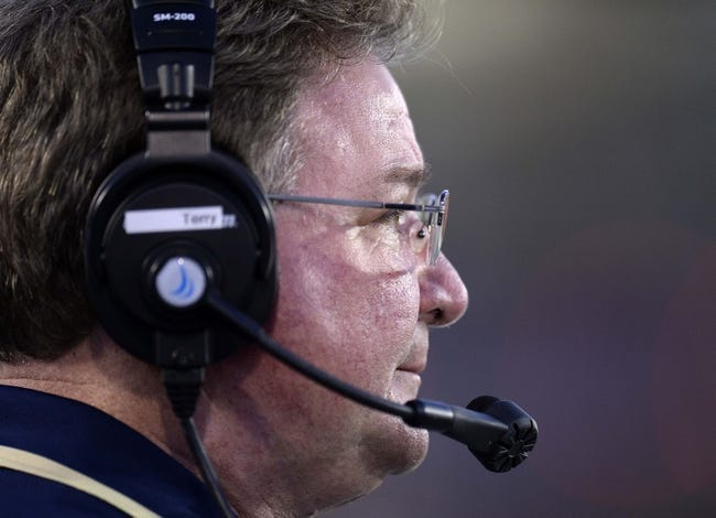 Oct 12, 2013; DeKalb, IL, USA; Akron Zips head coach Terry Bowden during the second half against the Northern Illinois Huskies at Huskie Stadium. Northern Illinois defeats Akron 27-20. Mandatory Credit: Mike DiNovo-USA TODAY Sports
