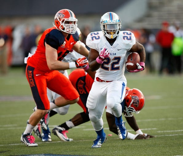 Oct 12, 2013; El Paso, TX, USA; Tulsa Hurricane running back Trey Watts (22) runs the ball against the UTEP Miners defense during the first half at Sun Bowl Stadium. Mandatory Credit: Ivan Pierre Aguirre-USA TODAY Sports