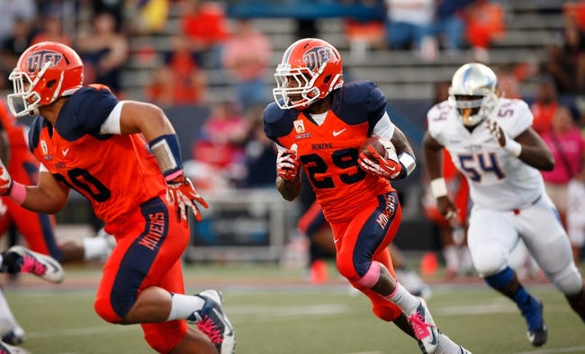 Oct 12, 2013; El Paso, TX, USA; UTEP Miners running back Aaron Jones (29) runs the ball against the Tulsa Hurricane defense at Sun Bowl Stadium. Mandatory Credit: Ivan Pierre Aguirre-USA TODAY Sports