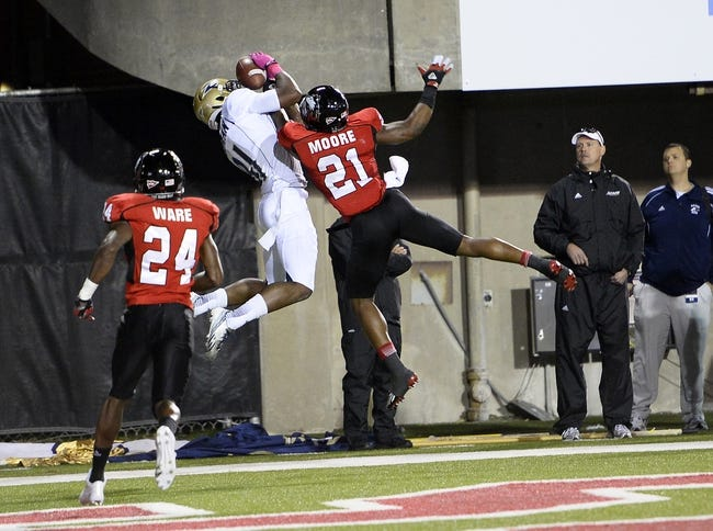 Oct 12, 2013; DeKalb, IL, USA; Akron Zips wide receiver Tyrell Goodman (81) makes a touchdown catch against Northern Illinois Huskies cornerback Marlon Moore (21) during the second half at Huskie Stadium. Northern Illinois defeats Akron 27-20. Mandatory Credit: Mike DiNovo-USA TODAY Sports