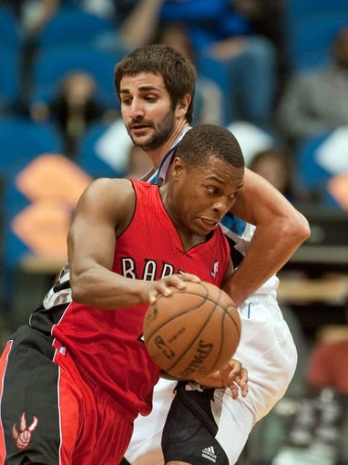 Oct 12, 2013; Minneapolis, MN, USA; Toronto Raptors shooting guard DeMar DeRozan (10) drives against Minnesota Timberwolves point guard Ricky Rubio (9) in the second quarter at Target Center. Mandatory Credit: Greg Smith-USA TODAY Sports