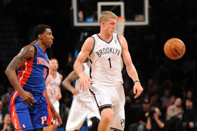 Oct 12, 2013; Brooklyn, NY, USA; Detroit Pistons shooting guard Kentavious Caldwell-Pope (5) and Brooklyn Nets power forward Mason Plumlee (1) go after a loose ball during the second half of the preseason game at Barclays Center. The Pistons won the game 99-88 Mandatory Credit: Joe Camporeale-USA TODAY Sports