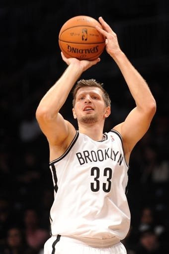 Oct 12, 2013; Brooklyn, NY, USA; Brooklyn Nets power forward Mirza Teletovic (33) takes a shot against the Detroit Pistons during the second half of the preseason game at Barclays Center. The Pistons won the game 99-88 Mandatory Credit: Joe Camporeale-USA TODAY Sports