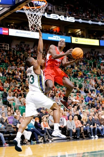 Oct 12, 2013; Salt Lake City, UT, USA; Los Angeles Clippers point guard Darren Collison (2) jumps over Utah Jazz small forward Mike Harris (33) to shoot the ball during the second quarter at EnergySolutions Arena. Mandatory Credit: Chris Nicoll-USA TODAY Sports