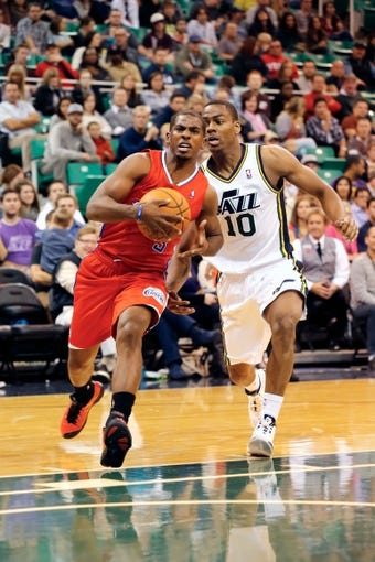 Oct 12, 2013; Salt Lake City, UT, USA; Los Angeles Clippers point guard Chris Paul (3) drives towards the basked while Utah Jazz point guard Alec Burks (10) tries to slow him down during the second quarter at EnergySolutions Arena. Mandatory Credit: Chris Nicoll-USA TODAY Sports