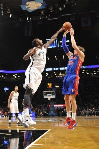 Oct 12, 2013; Brooklyn, NY, USA; Brooklyn Nets power forward Andray Blatche (0) blocks a shot by Detroit Pistons power forward Jonas Jerebko (33) during the second half of the preseason game at Barclays Center. The Pistons won the game 99-88 Mandatory Credit: Joe Camporeale-USA TODAY Sports
