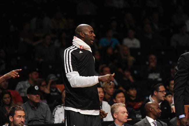 Oct 12, 2013; Brooklyn, NY, USA; Brooklyn Nets power forward Kevin Garnett looks on against the Detroit Pistons during the second half of the preseason game at Barclays Center. The Pistons won the game 99-88 Mandatory Credit: Joe Camporeale-USA TODAY Sports