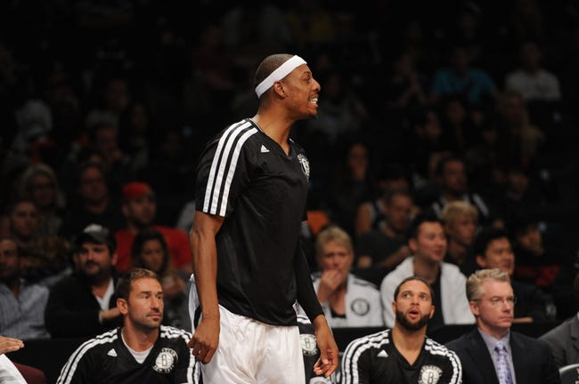 Oct 12, 2013; Brooklyn, NY, USA; Brooklyn Nets small forward Paul Pierce (34) looks on against the Detroit Pistons during the second half of the preseason game at Barclays Center. The Pistons won the game 99-88 Mandatory Credit: Joe Camporeale-USA TODAY Sports