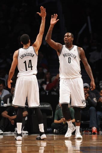 Oct 12, 2013; Brooklyn, NY, USA; Brooklyn Nets power forward Andray Blatche (0) and Brooklyn Nets point guard Shaun Livingston (14) high five during the second half of the preseason game at Barclays Center. The Pistons won the game 99-88 Mandatory Credit: Joe Camporeale-USA TODAY Sports