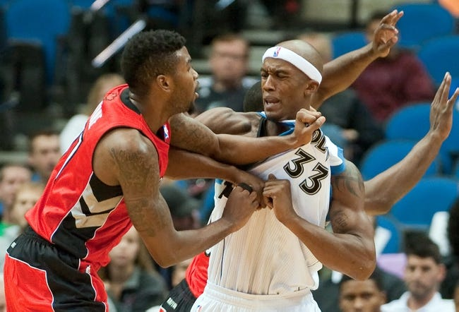 Oct 12, 2013; Minneapolis, MN, USA; Toronto Raptors point guard Julyan Stone (77) and Minnesota Timberwolves power forward Dante Cunningham (33) collide with one another in the fourth quarter at Target Center. Raptors won 104-97. Mandatory Credit: Greg Smith-USA TODAY Sports