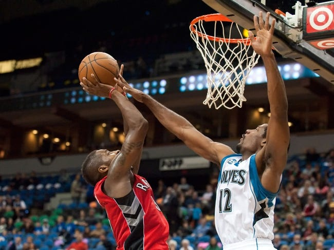 Oct 12, 2013; Minneapolis, MN, USA; Toronto Raptors shooting guard Terrence Ross (31) shoots and is fouled by Minnesota Timberwolves shooting guard Othyus Jeffers (12) in the fourth quarter at Target Center. Raptors won 104-97. Mandatory Credit: Greg Smith-USA TODAY Sports