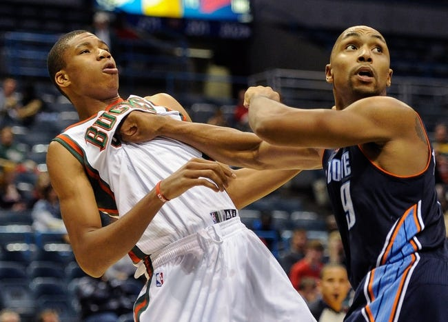 Oct 12, 2013; Milwaukee, WI, USA;   Milwaukee Bucks guard Giannis Antetokounmpo (34) is blocked out by Charlotte Bobcats guard Gerald Henderson (9) in the 3rd period at BMO Harris Bradley Center. Mandatory Credit: Benny Sieu-USA TODAY Sports