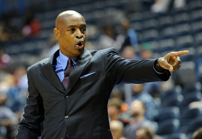 Oct 12, 2013; Milwaukee, WI, USA;   Milwaukee Bucks head coach Larry Drew calls out a play during the game against the Charlotte Bobcats at BMO Harris Bradley Center. Mandatory Credit: Benny Sieu-USA TODAY Sports