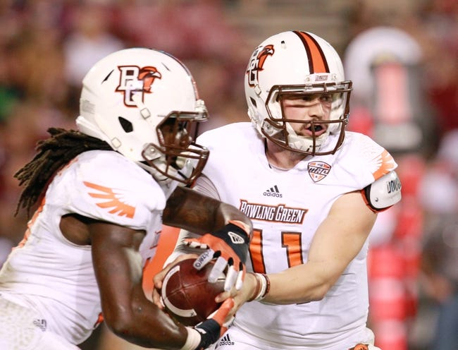 Oct 12, 2013; Starkville, MS, USA; Bowling Green Falcons quarterback Matt Johnson (11) hands the ball off to running back Travis Greene (13) during the game against the Mississippi State Bulldogs at Davis Wade Stadium. The Bulldogs defeated the Falcons 21-20. Mandatory Credit: Marvin Gentry-USA TODAY Sports