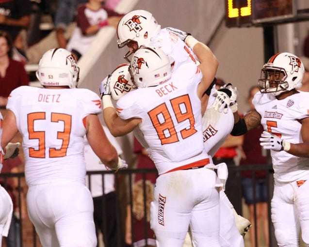 Oct 12, 2013; Starkville, MS, USA; Bowling Green Falcons quarterback Matt Johnson (11) celebrates with teammates after scoring a touchdown against the Mississippi State Bulldogs at Davis Wade Stadium. The Bulldogs defeated the Falcons 21-20. Mandatory Credit: Marvin Gentry-USA TODAY Sports